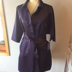 Long silky polyester coat with front closing snaps